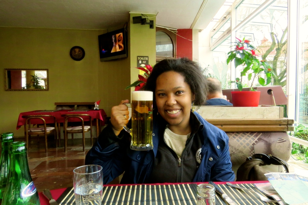 """Jess with her overpriced """"cheap"""" Czech beer."""
